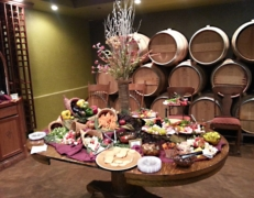 Oak Barrel Room with a table full of hors d'oeuvres and barrels stacked high in background